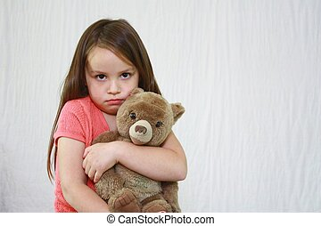 Young cute girl hugging little teddybear. - Young girl with...