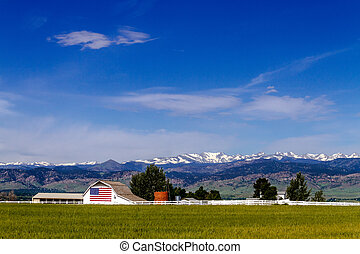 American Flag Barn in Boulder, CO - White barn with American...