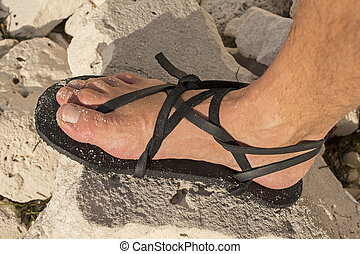 Adventure sandals - Closeup of man's foot wearing homemade...