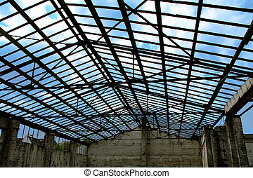 old broken warehouse with damaged roof