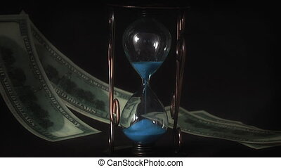 Money flying on background hourglass