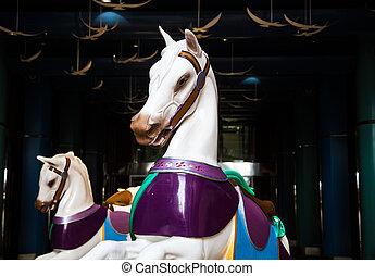 Two White Carousel Horses on Dark Promenade