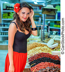 Spanish woman in the market is choising products