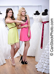Buying Wedding Dress - Two girlfriends - bridesmaids- having...