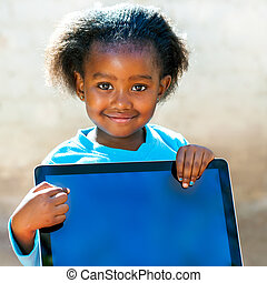 African kid pointing at blank digital screen. - Close up...