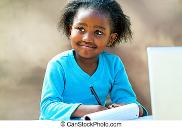 Afro student doing schoolwork. - Portrait of African girl...