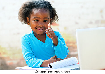 African student doing thumbs up. - Smiling little African...