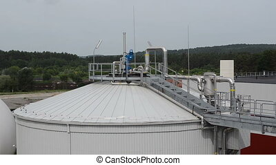biogas plant sludge - Modern biogas plant using water...
