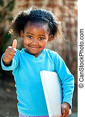 Cute african girl with notebook. - Positive African girl...