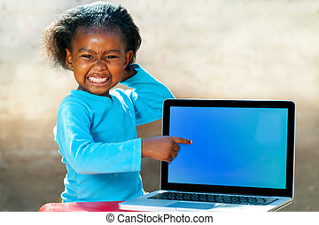 Funny african girl pointing at blank screen. - Portrait of...