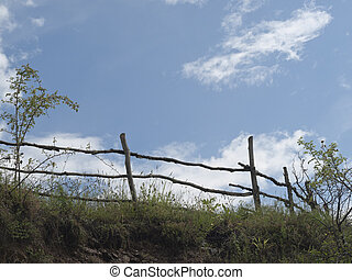 Sky, clouds and old wooden fence