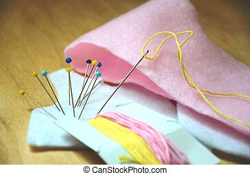 Sewing - a neddle and pins - Sewing - a neddle and colorful...
