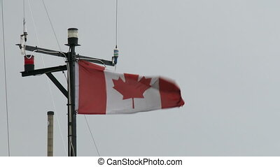 Canadian flag waving on a boat - Canadian flag waving on top...