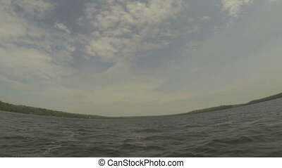 Point of view of rower on a canoe on Canadian lake, with...
