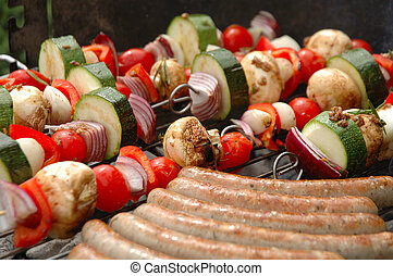 barbecue - shish-kebab and sausages cooking on barbecue