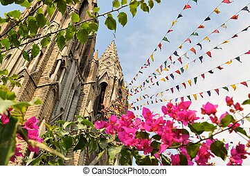Mysore gothic Cathedral with colorful prayer flags - St...