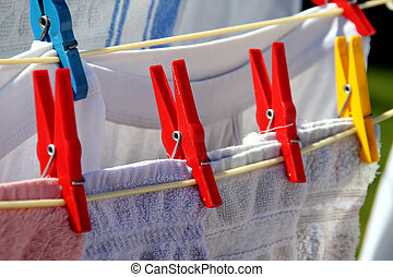rotary clothes drier with different clothes on it