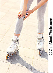 Knee pain while roller blading - A picture of a woman having...