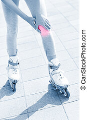 Knee pain during roller blading - A picture of a woman...