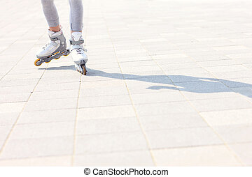 Woman roller blading - A picture of womans legs with roller...
