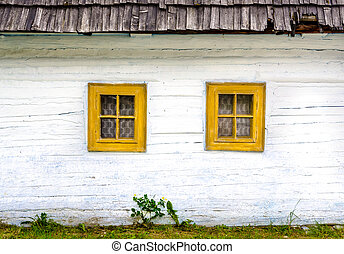 Detail of colorful windows on old traditional house,...