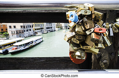 Padlocks of lovers placed on the bridge in Venice