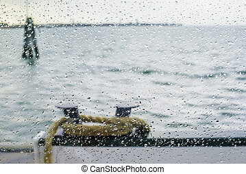 Rain on glass ship