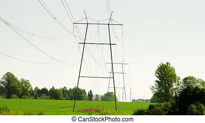 Two big electric posts with wires - Two big electric metal...