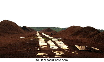 Lots of red peat heaps with wooden trails in between