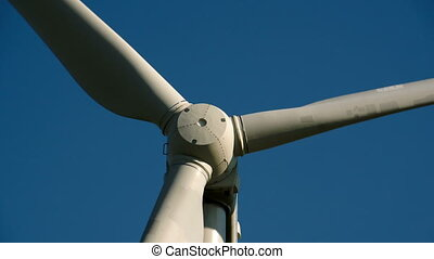 Closer look of the windmills propeller slowly turning