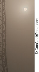 stream-mast in the fog on a field in the morning