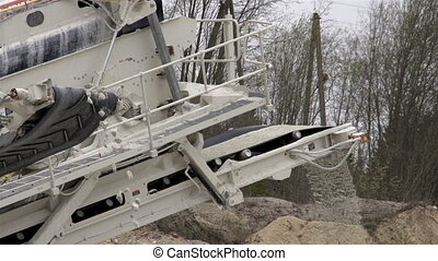 A machine called splinter used for splitting rocks to...