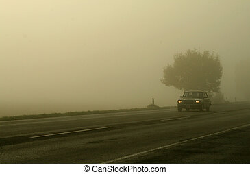Car in Fog - car in the fog on a highway