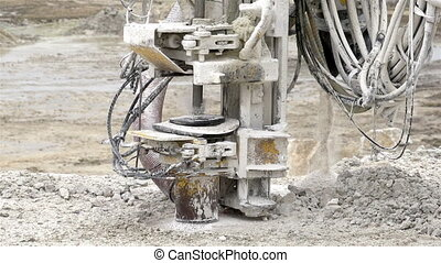 An equipment drilling the ground - An equipment called rock...
