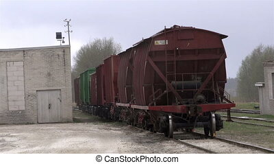 Outside view of the limestone factory with a cargo train...
