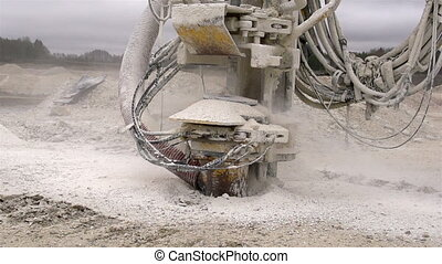 A rock drilling machine exploding fine limestones on the...