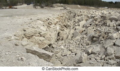 Big rocks from a limestone mining - Big cracked rocks from a...