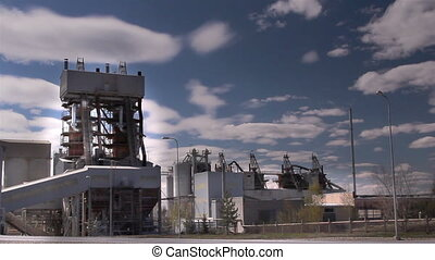 A limestone factory with tall buildings - A limestone...
