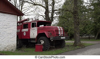 An old red truck on standby - An old red truck that is no...