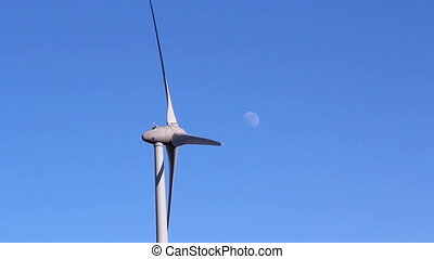 The windmills propeller is turning - The white windmill s...