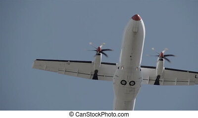 An airplane s propeller turning slow - An airplane s...