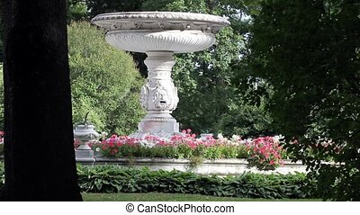 marble fountain among the flowers