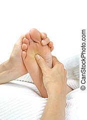 Reflexology Treatment - Reflexologist holding patients foot...