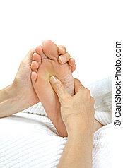 Reflexology Treatment - Reflexologist holding patient's foot...