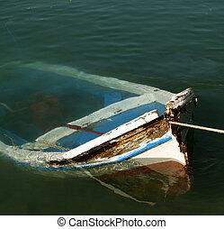old sunken rowing boat