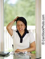 Mature woman expressing extreme Stress - Vertical image of...