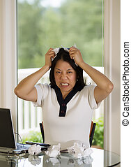 Mature woman ripping work papers in Anger - Vertical image...