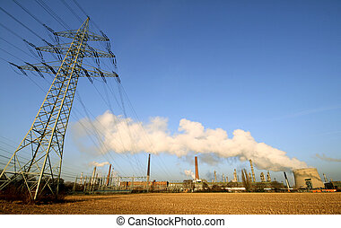 heavy industrie with smoke in the sky