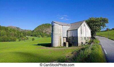 Norwegian Grain Silo 010 - Old grain silo and barn next to a...