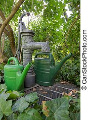 Pump well and watering cans 04 - Traditional pump well with...